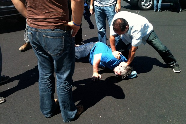 Bystanders bring the assailant to the ground, until police can arrive. Photo by Josh Rottman
