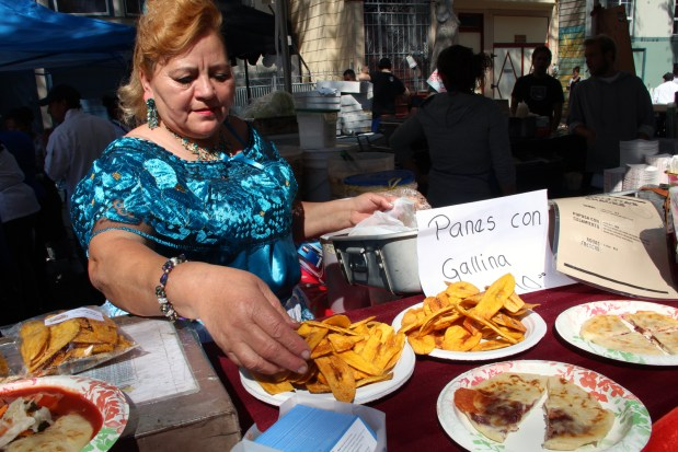 Maria del Carmen shows off her Salvadoran dishes at the San Francisco Street Food Festival. Photo by Jamie Goldberg.