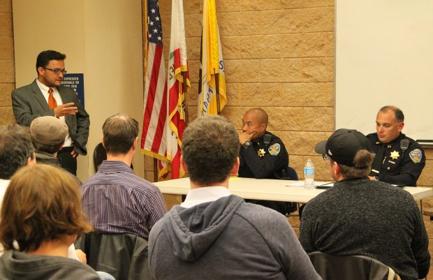 Supervisor Campos speaks to Captain Moser and community members.