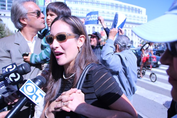 Eliana Lopez talks to the media as she arrives at the noontime rally before the Supervisors' hearing in 2012. File Photo by Alana Levinson.