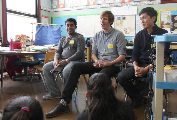 Project Managers Sachin Agarwal, Brian Ellin and Sung Hu Kim talk about their jobs at Twitter with students from Cesar Chavez Elementary School.