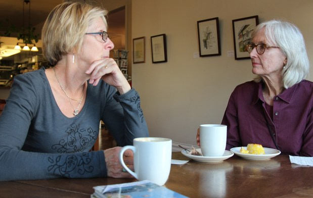 Peggy Hammett and Ann lockett chat over coffee and pastries at Borderlands Books.