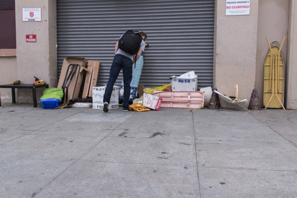 A man browses through the dumped goods at Salvation Army.