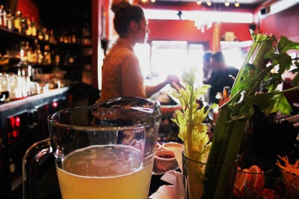 A bartender at Luna Park serves patrons.