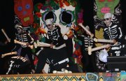 """Skeleton drummers bang to the beat in """"Marcadia."""" Music and choreography produced by students. Photo by Erica Hellerstein"""