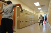 Anas Belloozi from Morocco and Sai Bathal from India practice badminton in the hallway of San Francisco International High School. The high school has no gym so players practice in the hallway or outside in the basketball courts.