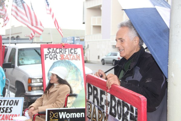 Erika Hathaway and Ross Foti protest outside the Planned Parenthood on Valencia St. every Thursday morning. Contentions have risen recently about their use of space in front of the clinic. Photo by Carly Nairn.