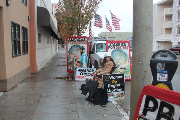 Erika Hathaway sits in her wheelchair in front of the Valencia Street Planned Parenthood. A new ordinance would require that she protests 25-feet away from the entrance. Photo by Carly Nairn.