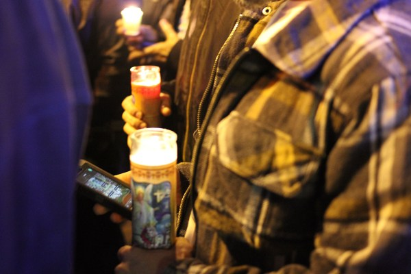 The vigil was well-documented on attendees' smartphones. Photo by Anne Hoffman.