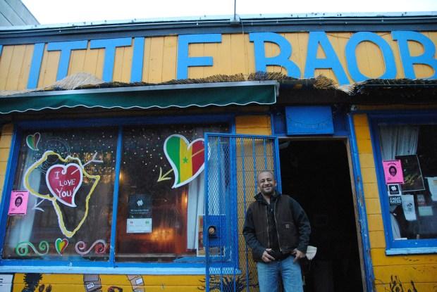 Image shows Marco Senghor outside his restuarant.