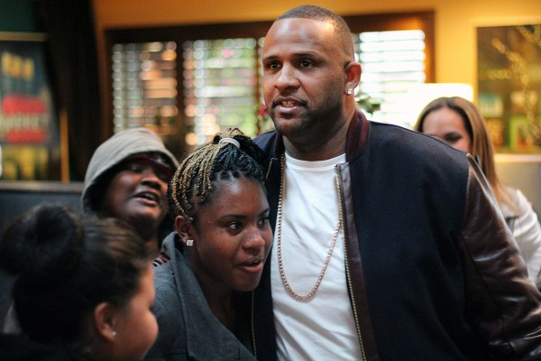 The teenagers surround Yankees starting pitcher CC Sabathia as he arrives at Mission Bowling Club.