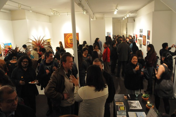Around 100 people packed Galería de la Raza on Thursday night to see Mayan inspired art. Photo by Alejandro Rosas.
