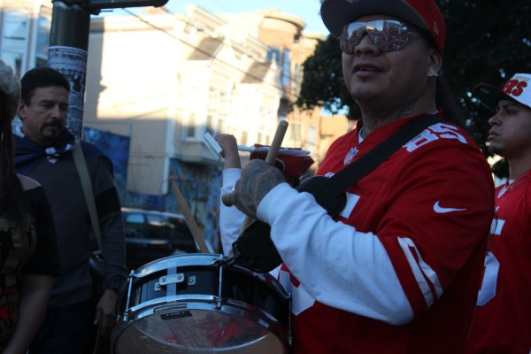 A 49ers fan and his drum on 23rd and Mission streets.