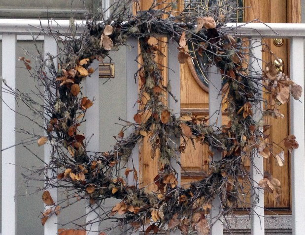 A wreath hung outside someone's house.