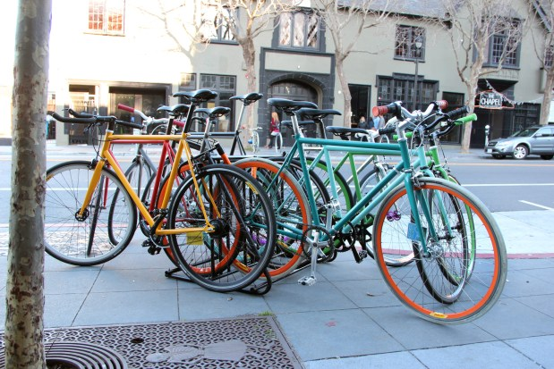 A group of bikes parked on Valencia St.