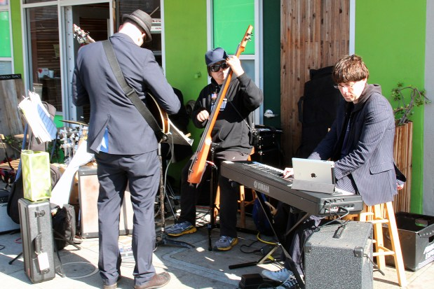 A band plays on Mission Street near Cesar Chavez Street.