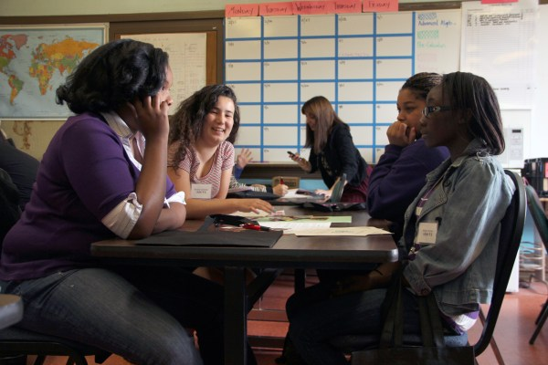 Annaki Geshlider, at far left, and other young women engage in a conversation during a reproductive rights workshop at Mission High School.
