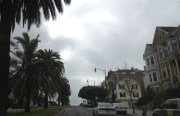 The view going up Dolores Street on a cloudy day.