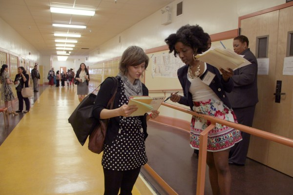 Fatimah Simmons directs a young woman as she searches for workshops.