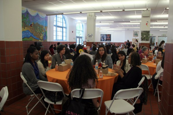 Young women and local politicians gather for a one-on-one lunch.