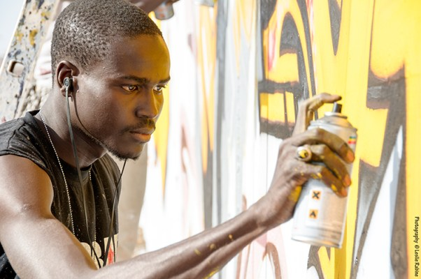 "Festigraff, Day 1: The HLM neighborhood. Artist Mad Zoo (Serigne Moumar Fall) works on a wall. The message for this wall is: ""Believe in yourself however long it takes, and you will have success."""