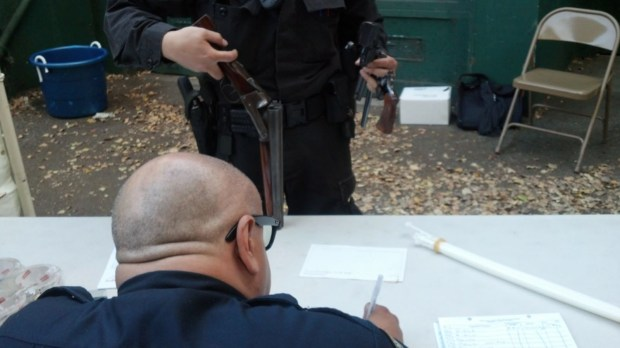 Officer Smith records information on the guns that were turned in at the buyback.