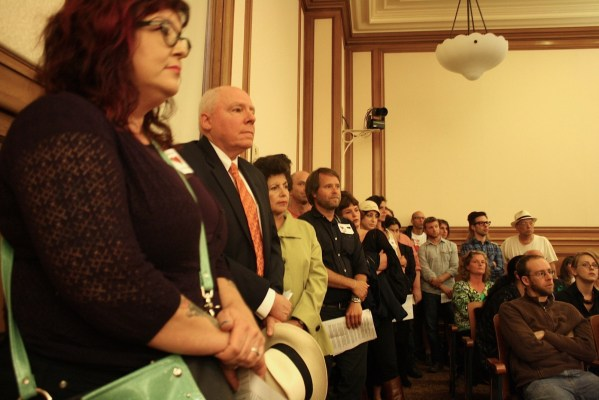 Members of the community line up to give testimony supporting or opposing the arrival of Jack Spade at a August 14 Board of Appeals hearing. Photo by Daniel Hirsch.
