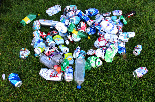 "A pile of plastic bottles and cans sits on the ground in Dolores Park. ""I think it's mostly drunk people that leave the trash,"" said Eric Ingersoll, a 30-year-old East Bay resident who sells coffee and tea to park-goers on the weekends. ""It's not intentional. Everyone else throws away their trash or leaves cups and..."