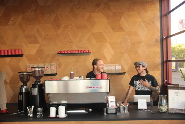 Baristas Tom Baker (left) and Ant Walach (right) share a joke during a quick break from the action.