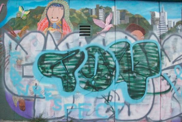 "The second round of graffiti on Susan Green's ""Creativity Explored Project"" on 21st Street features the word ""Toy."""