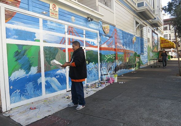 The mural on 23rd Street is being turned back into a garage.  The work on the right will be left alone. Photo by Lydia Chávez