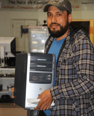 Joel Vasquez picking up his computer from The Network Store