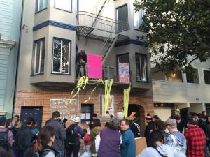 Protestors hold piñatas. Photo by Andra Cernavskis.