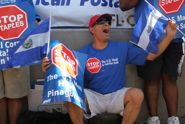 "Carlos Nerio, 50, driver for the U.S. Postal Service. ""I am here to support my union and to fight against the privatization of the Postal Service. If that happens, it would jeopardize my job and I wouldn't be able to send my kids to college."" Photo by Stefania Rouselle."