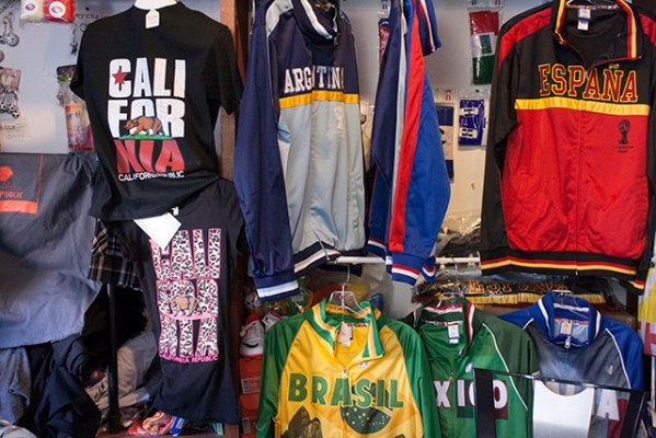 The shop is now known for its collection of soccer shirts and flags. Photo by Laura Wenus
