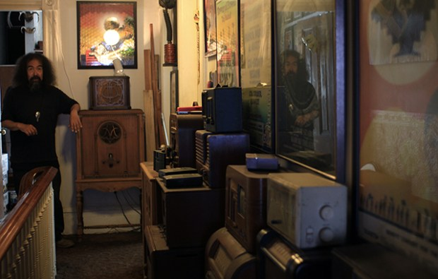 The hallway full of radios posters and his art. Photo by Claudia Escobar
