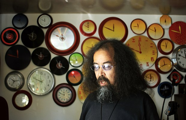 Dogpaw in his kitchen, with a collection of clocks. Photo by Claudia Escobar