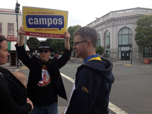 A supporter out on Valencia and 22nd streets on Monday evening. Photo by Lydia Chávez
