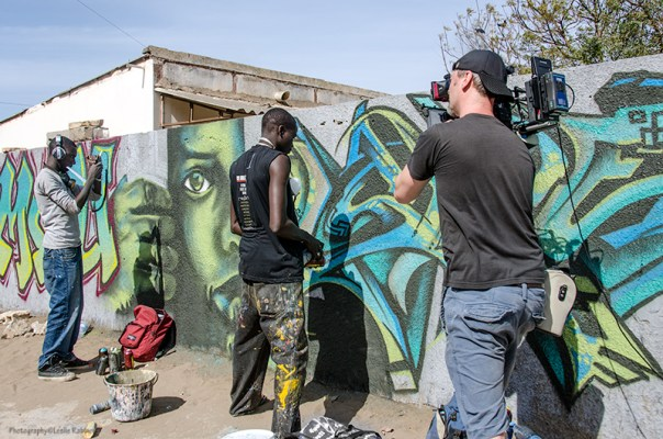 Wall #1: The crew of the U.S. TV program House Hunters International shows up to film an episode featuring Dakar graffeur Mad Zoo.