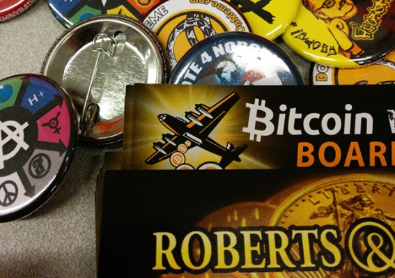 Charities and organizations that work with Bitcoin had plenty of flair to offer. Photo by Laura Wenus