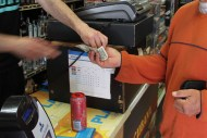 File photo: A customer purchases a drink at at a Mission Street market.
