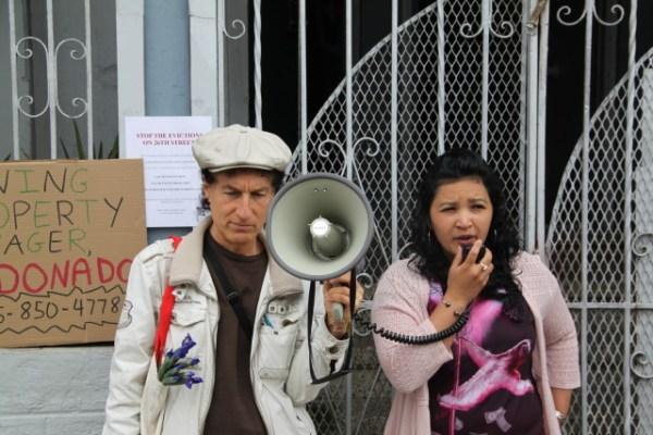 "Tenant Mayra Alvarado dares Maldonado to come out of his apartment, with the crowd chanting ""Come out Maldonado! Come out and face us!"" Photo by Joe Rivano Barros."