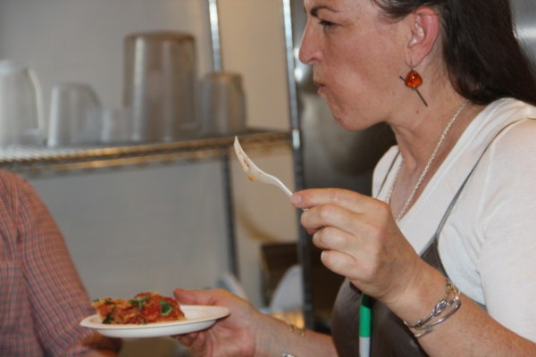 Baker Lisa Zeibel, who works at Mission Pie, trying the tomato pie. Photo by Joe Rivano Barros.