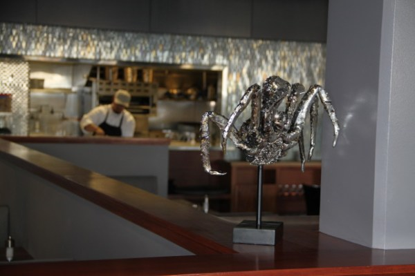 A crab and his claws greet patrons, and in the back the kitchen is open for curious onlookers. Photo by Joe Rivano Barros.