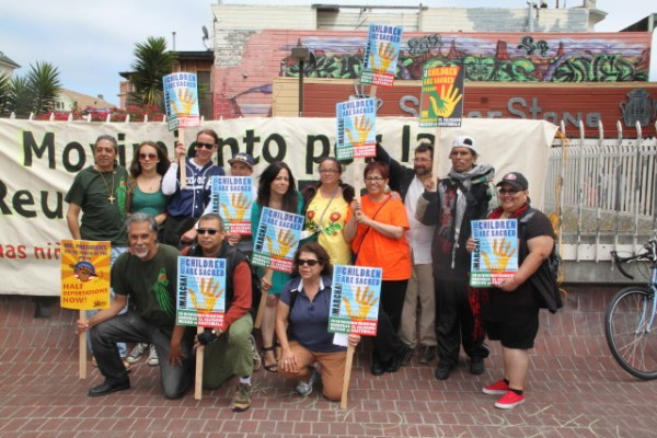 Organizers take a celebratory photograph at the end of what they deemed a successful march. Photo by Joe Rivano Barros.