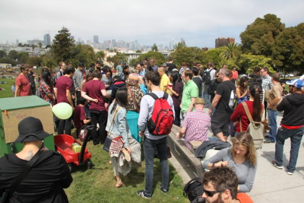 Dozens and dozens of onlookers surrounded some four or five cats in the middle of Dolores Park. Most seemed disappointed at the low turnout, cat-wise. Photo by Joe Rivano Barros.