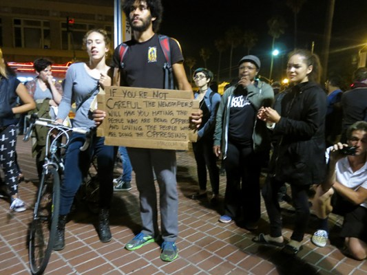 Speakers talked about Ferguson and allying with the Alex Nieto march on Friday. Photo by Lydia Chávez