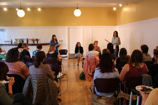 Anne Diaz (standing, right) and Jena Fiamingo (standing, left) introduce last month's speakers at a Rosie's Daughters conversation at the Women's Building.