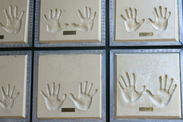 These handprints of Latino pop stars adorned Ritmo Latino for years; now they're gone. Photo by Gerard Koskovich, and Preserving LGBT History