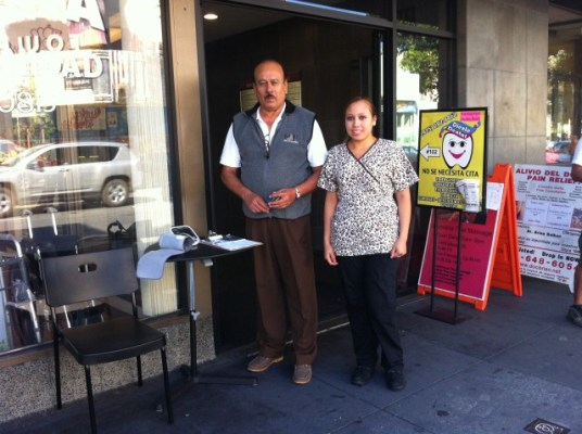 René Infante and Karen Merino outside the Meridian Medical Group Clinic on Mission Street. Photo by Andrea Valencia